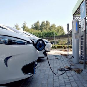 An parked electric car plugged in to charge